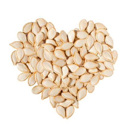 pumpkin seeds: Heart from pumpkin seeds isolated on white background
