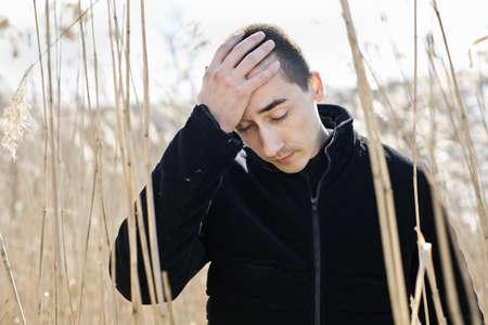 reed: depressed man  Stock Photo