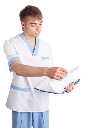 The young medical doctor looks in a clipboard isolated on white background photo