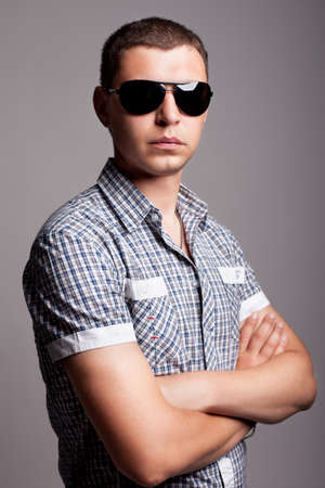 serious young man in sunglasses
