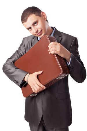 young businessman embraces portfolio  isolated on white background photo