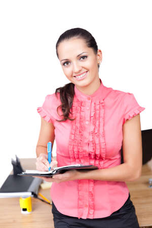 young happy smiling business woman taking notes at the office Stock Photo - 10876431