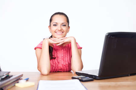 happy beautiful young business woman sitting at office desk Stock Photo - 10876440