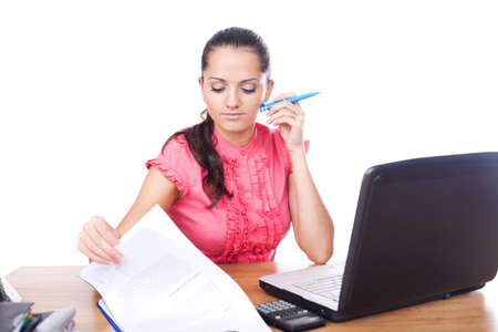beautiful young business woman sitting at office desk and reads contract Stock Photo - 10876323