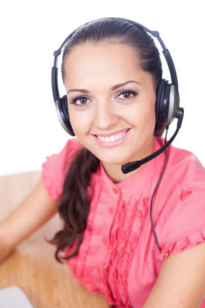 Young beautiful call center female operator isolated on white background Stock Photo - 10876422