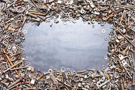 assorted nuts and bolts frame on metal texture background photo