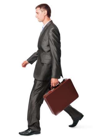 goes: businessman with case walking, isolated on white background Stock Photo