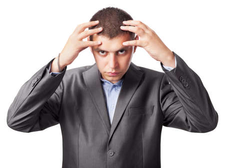 preoccupation: the young businessman thinks keeping hands for a head on white background Stock Photo