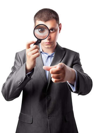 magnifier: businessman in a suit looking through a magnifying glass isolated on white background