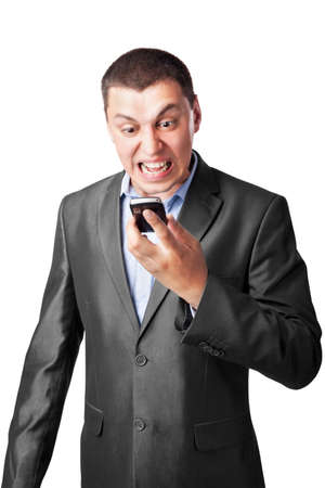An angry businessman screaming in cell mobile phone isolated on white background photo