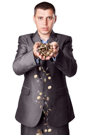 hurl: young businessman with heap of coins isolated on white background Stock Photo