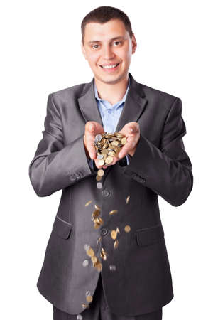 hurl: young smiling businessman with heap of coins isolated on white background