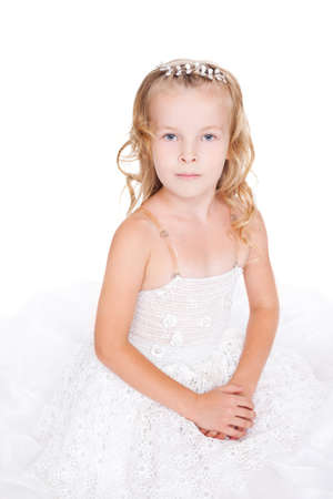 beautiful little girl in white dress isolated on white background photo