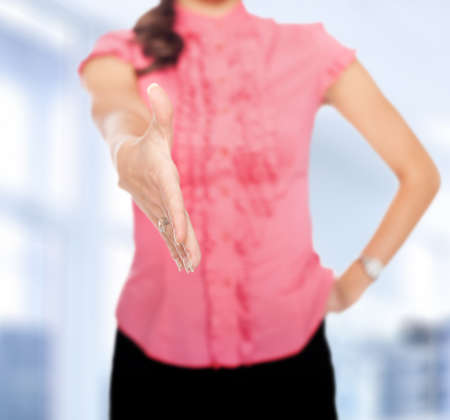 extending: business woman extending hand to shake isolated on white background