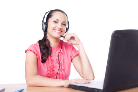 young happy smiling woman sitting at office desk with headset isolated on white background photo