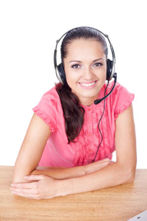 call center female operator. young happy smiling woman sitting at office desk with headset isolated on white background.  photo