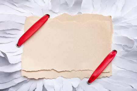 ripped piece of paper with red ribbon. Handmade card Stock Photo - 12024726