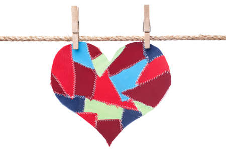 flap:  fabric scraps heart hanging on the clothesline. Isolated on white. Valentines Day