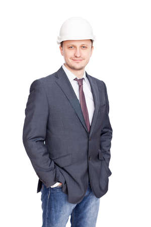Engineer with white hard hat standing confidently isolated on white background photo
