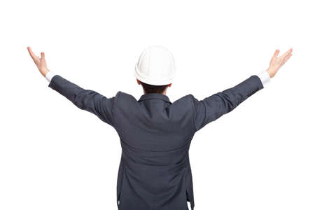 Engineer standing back view holding his arms up isolated on white background photo