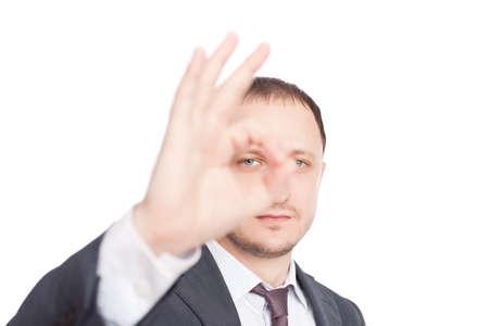 Young businessman showing symbol OK isolated on white background photo