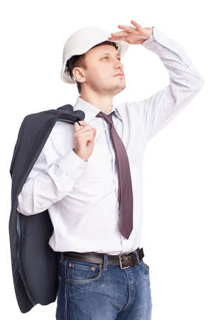 Young engineer looking far away holds jacket behind shoulder isolated on white background Stock Photo - 12455176