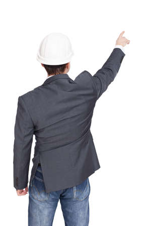 Ingegnere standing vista posteriore a qualcosa di isolato su sfondo bianco Archivio Fotografico