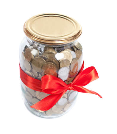 closed ribbon: Coins in the jar with red ribbon on white background