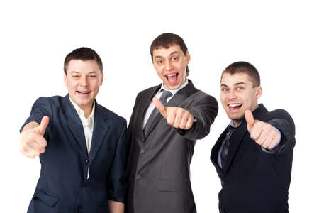 Three young  business men laughing and giving the thumbs up sign isolated on white background photo