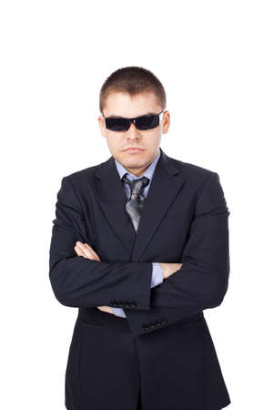 body guard: Security guard wearing a suit and sunglasses isolated on white background