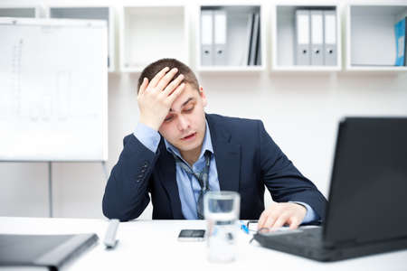 bored man: Thoughtful or stressful businessman at work