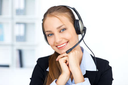 receptionists: Portrait of pretty young female operator