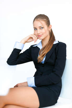 Portrait of cute young business woman sitting at the desk  Stock Photo