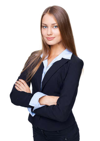 Portrait of young smiling businesswoman standing with hands folded against isolated on white background photo