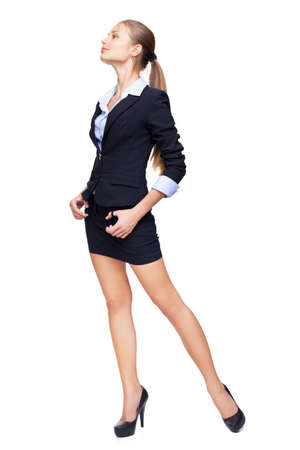 secretary skirt: Full length portrait of a beautiful business woman  looking off into the distance isolated on white background