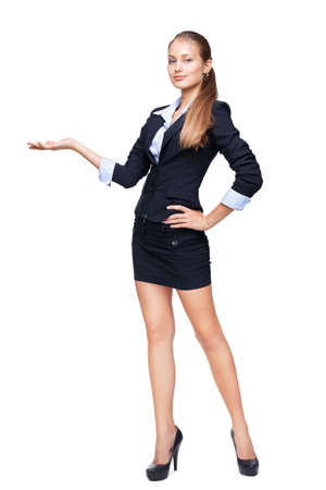 skirt suit: Full length portrait of a young beautiful business woman shows something isolated on white background