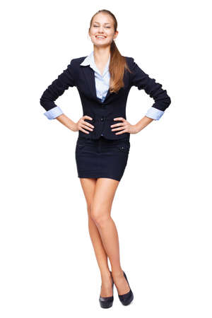 Full length portrait of a young beautiful business woman isolated on white background photo