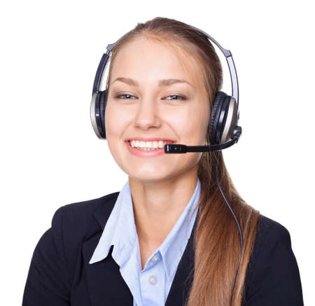 Closeup portrait of young female call centre employee with a headset on white background Stock Photo - 15896866