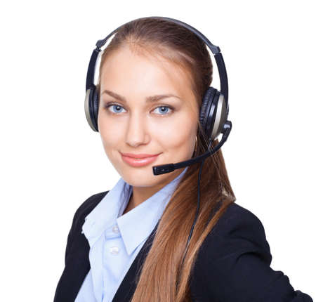 switchboard: Closeup portrait of young female call centre employee with a headset on white background Stock Photo