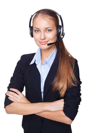 Portrait of young female call centre employee with a headset on white background photo