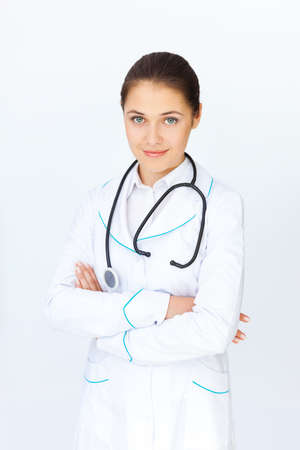 Portrait of young female doctor with arms crossed photo