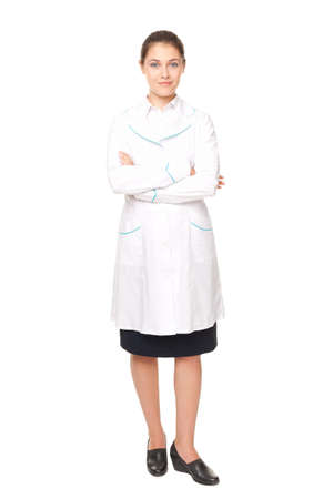 Full length portrait of young female doctor solated on white background photo