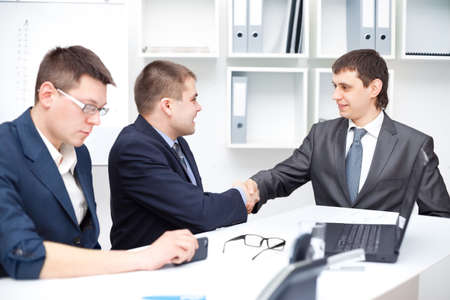 Business agreement among businesspeople photo