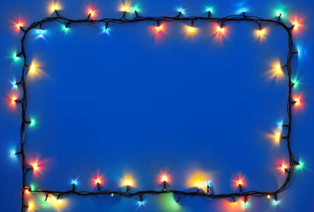 christmas illuminations: Christmas lights on dark blue background with copy space  Decorative garland