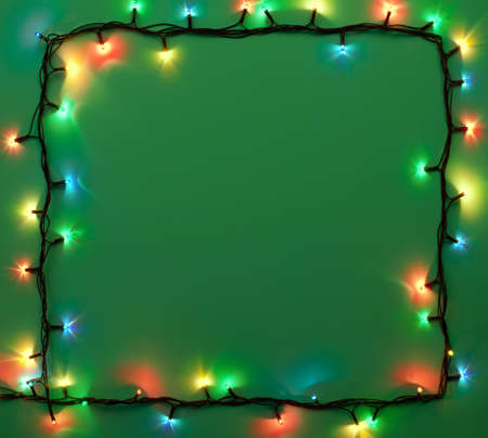 Christmas lights on green background with copy space  Decorative garland photo