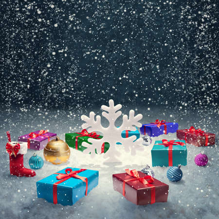 x mas: Christmas gift box with christmas balls and big snowflake on snow  Christmas concept Background