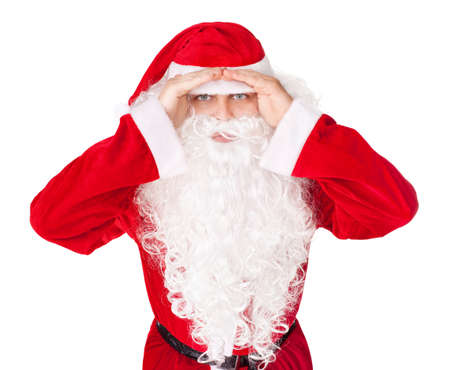 far away look: Portrait of Santa Claus look far away hold hands at head isolated on white background Stock Photo