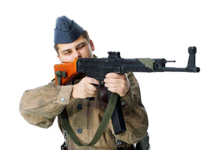 Soldier shoots submachine gun isolated on white background Stock Photo - 17475727