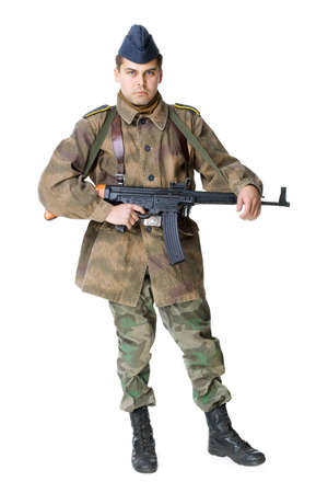 Portrait of german soldier with submachine gun isolated on white background photo