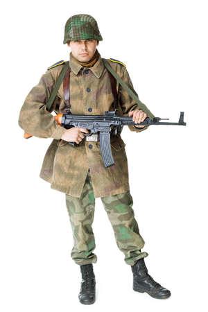 vintage gun: Portrait of soldier with submachine gun isolated on white background Stock Photo
